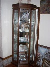 Corner Curio cabinet with lights and glass shelves