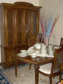 China Hutch has a light inside and the glass shelves allow the light to pass through, Dining Table has one Extension and 6 Chairs