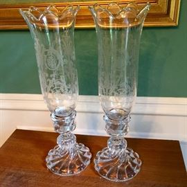 Baccarat crystal candle holders with etched shades.