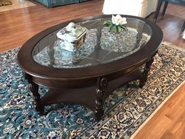 Glass and Mahogany oval coffee table