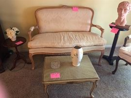 Small settee with down filled cushions, coffee table, plant stands