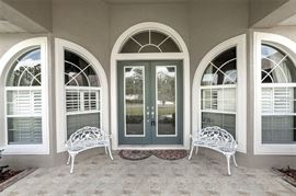 Home is newly listed for sale as well, the wrought iron benches sold as a set