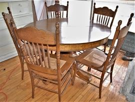 Lot# 3 Antique Round Carved Oak Pedestal Table w/ Leaves Lot# 4 5 Antique Oak Pressed Back Chairs with Cane Seats
