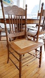 5 Antique Oak Pressed Back Chairs with Cane Seats
