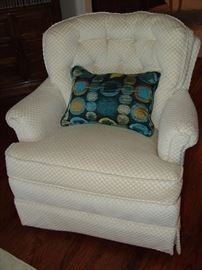 One of 2 upholstered swivel chairs