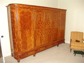 Very nice floral inlaid armoire in French design, breaks down into components