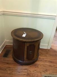 #60Kw tableround end table w door $125.00