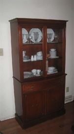 China cabinet with glass doors, plate racks on two top shelves, two  shelves  below