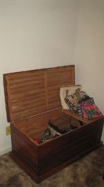 Open cedar chest and purses