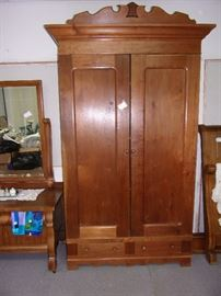 Beautiful Armoire: 2 shelves on the bottom, shelves and hanging room inside!