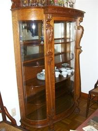 Great oak china cabinet with curved glass.