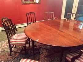 Custom oval dining table with spoon foot legs handcrafted by Windsor Chairmakers.  Seats 8.