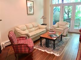 Downs stuffed arm chair and leather sofa/chair