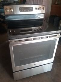 GE electric stove, like new, used twice. Oven never used. Wife wanted gas. All books and accessories included.