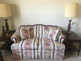 Traditional love seat with floral pattern