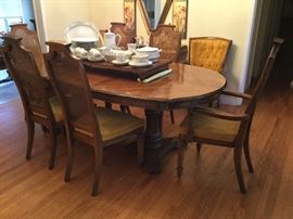 Dual pedestal dining table with two leaves and six chairs, all good
