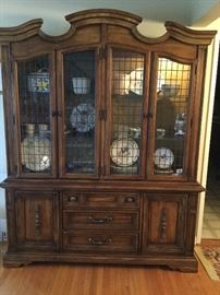Large China Cabinet with leaded glass doors, both sides lighted, shown with one side lighted