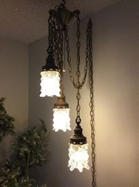 Three light hanging fixture just plugs into wall, cord is caught up and messy but it is already made into three lengths and ready for your not so humble abode.
