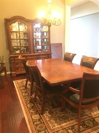 Matching 8 chair dining table with leaf and China Cabinet