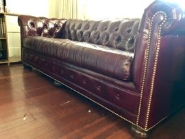 Solid top grain studded leather Chesterfield sofa bed.  Excellent condition!