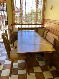 Solid oak kitchen banquette with two side chairs.  Adjustable table length