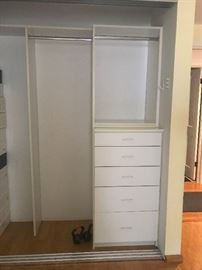 Custom closet drawers, beautiful formica  laminate material from the California Closets,  smooth open and close.   All tracks in excellent condition