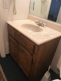 Beautiful vanity.   Easy to clean.  Cabinet in very good condition. With hardware.