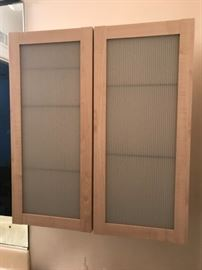 Ikea Cabinets.   Excellent condition.   high quality glass shelves. Adjustable.
