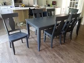 Gorgeous kitchen/dining room table and six chairs. Chalk painted in matt black! Plus has another leaf!