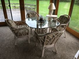 Rattan furniture: glass-top table w/chairs.