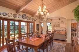 Large rustic dining table with 10 chairs.