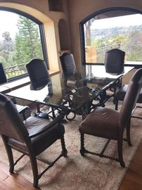 Large 8 foot glass table with hand forged base table