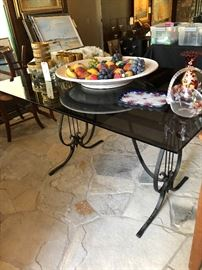 Iron Lyre and smoked glass table, art candle holders, cane bottom chairs 3 (gold rimmed glasses are sold)