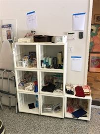 Band aids, gloves, products, walker, ironing board, stools, ladders