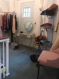 Just a glimpse of our fashion boutique -- still being set up.  Lots of designer clothing, including St. John and possibly Chanel (two suits...will add pic);  some vintage clothing; vintage vanity table; accessories, designer purses; etc. etc.