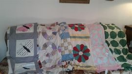 Dozens of quilt tops. Quilts, cutter quilts, bed spreads, linens