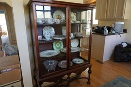 China cabinet, plates and platters