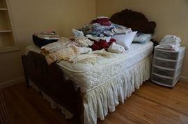 bed, linens, plastic storage unit