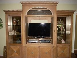 Wall unit shown with self-storing doors open