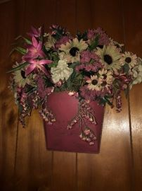 Wall hanging with floral arrangement