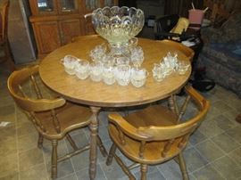 round dining table and 4 maple chairs
