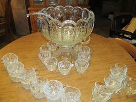 antique munch bowl' heavy glass with 10 cups and glass ladle; also we have an extra glass ladle and extra cups
