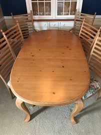 Dining Table with 2 arm chairs, 4 side chairs, 2 leaves.  Includes table pads.