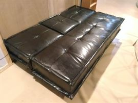 Black leather futon with fold down cupholders