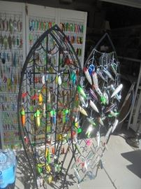 Opened swinging door on wine rack and displaying more lures.