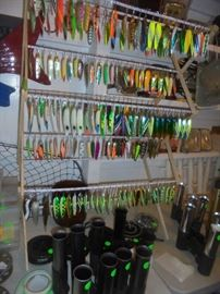Lures filling up a clothes drying rack with some unused pole holders in foreground