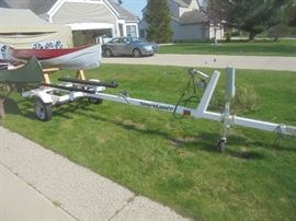 Shoreland'r trailer is also up for bid ending 4pm Wednesday.  Noticed label.... Tadpull 7 White 2003 and tires are 12x4