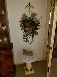 Pedestal and floral sconce