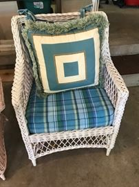 Vintage wicker chair with beautiful cushion