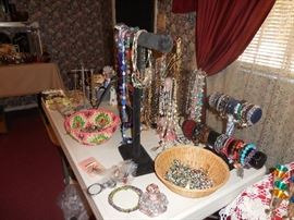 Table of jewelry, beaded and some other.  All sterling and better jewelry is in a display case.